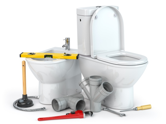 Plumbing repair service. Bowl and bidet with plumbing tools for a plumber and pvc plastic tubes.