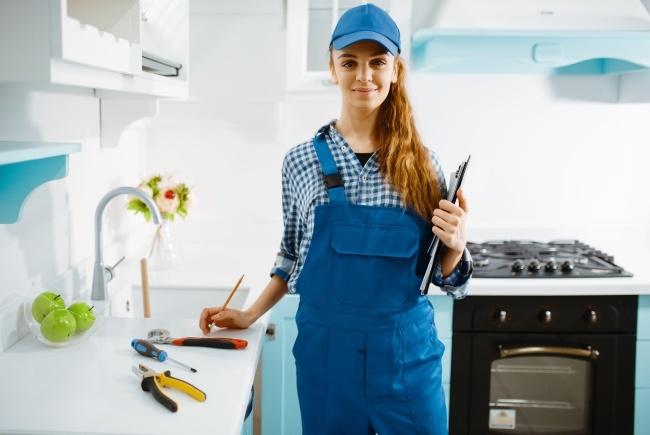 female-furniture-maker-in-uniform-holds-notebook