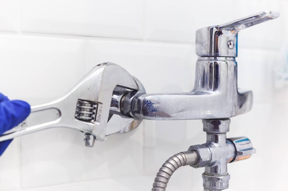 plumber-uses-pipe-wrench-for-service-shower-mixer